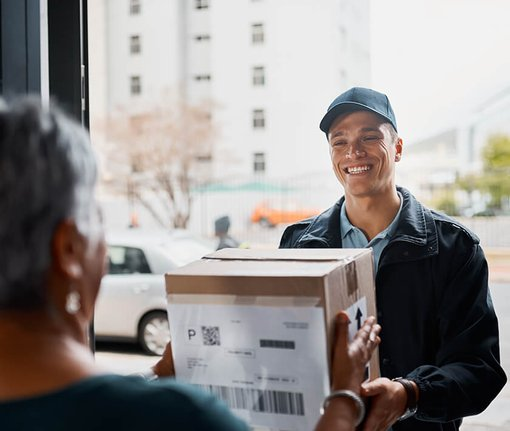 delivery man dropping off a package to a woman