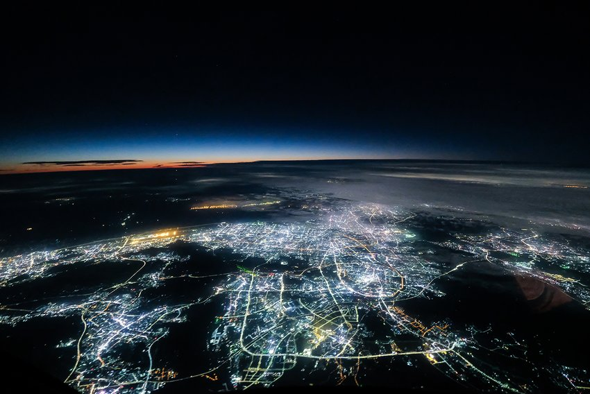 View of one side of the earth at night with lights lit up